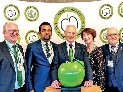 Representatives from Bogawantalawa Tea Estates being honoured as Green World Ambassador at the UK Parliament in Westminster, London